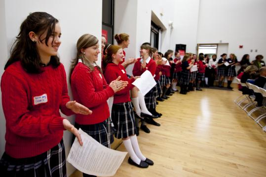 Saoirse Healy (left) joins other Montrose School students applauding a classmate&#8217;s talk during a recent open house for prospective students.