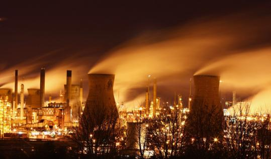 Carbon dioxide emissions, the chief man-made greenhouse gas, come from the burning of commodities such as oil, as seen here at the Grangemouth oil refinery in Longannet, Scotland.