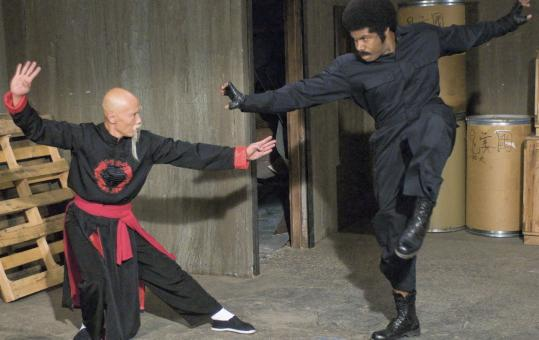 Black Dynamite (Michael Jai White, right) goes against Fiendish Dr. Wu (Roger Yuan).