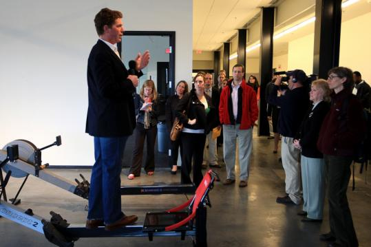 Bruce Smith, executive director of Community Rowing Inc., led a tour yesterday through the group's boathouse along the Charles River.