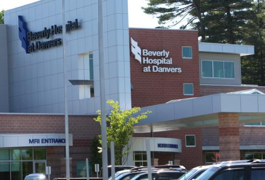 Beverly Hospital at Danvers and the facility in Beverly will share the elimination of 22 jobs.