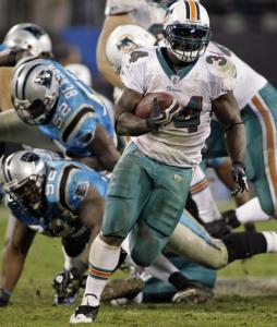 Ricky Williams breaks through the Carolina line on his way to a 46-yard touchdown run late in the fourth quarter.