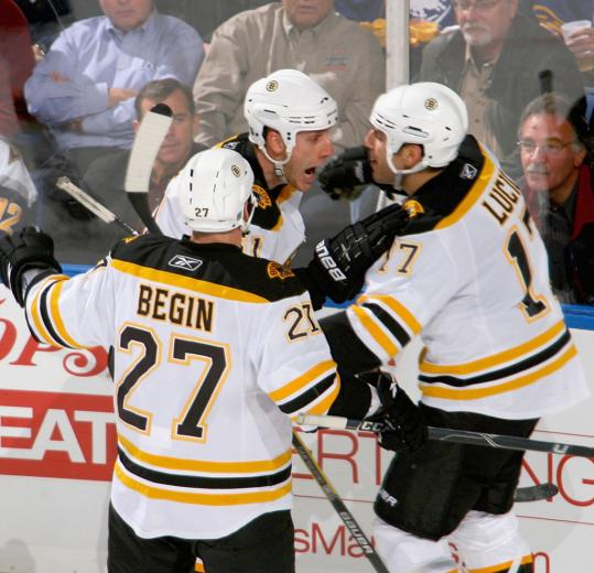 Milan Lucic's first goal of the year, set up by an excited Byron Bitz, got the Bruins on the board.