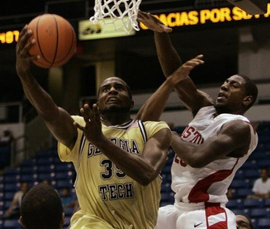 Georgia Tech's Zachery Peacock (left) puts a move on John Holland that leaves the BU swingman swiping at air.