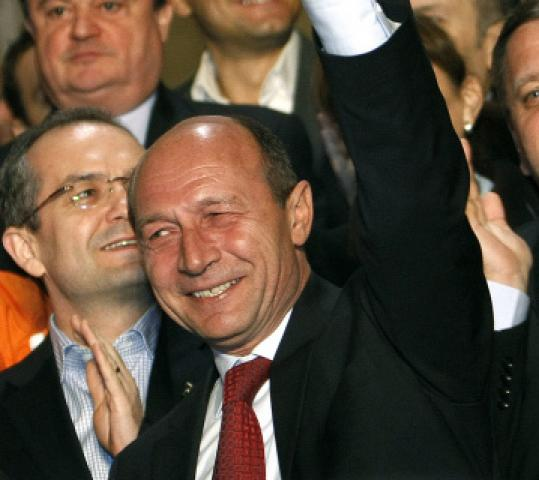 President Traian Basescu will compete in a runoff election with former foreign minister Mircea Geoana on Dec. 6.