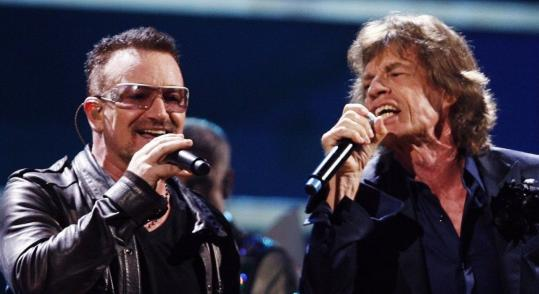 LUCAS JACKSON/REUTERS Bono and Mick Jagger make up one of the many superstar pairings featured in the DVD set.