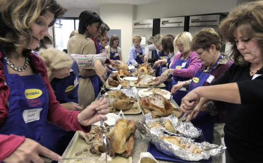Butterball Turkey Talk-Line specialists took part in cooking and carving classes during day one of the 29th season of Butterball University in October in Naperville, Ill. Automated the rest of the year, the hot line goes live each November and December.