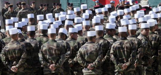 Legionnaires on parade on Armistice Day in Afghanistan. The French Foreign Legion's contingent there consists of 750 men from 80 different nationalities.
