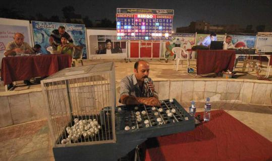 An employee at Baghdad's Alwiyah Club called out the winners of a bingo game. After years of violence drove most of its members away, Baghdad's elite social club is seeing a resurgence, and the crowd can reach hundreds on bingo night.