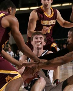 Butler's Gordon Hayward was surrounded by Golden Gophers, but kept his hands on the ball during the first half.