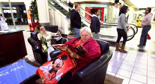 Donna Tevepaugh of Lowell waited yesterday at 4:45 a.m. for stores to open at the Mall at Rockingham Park, across the border in Salem, N.H.