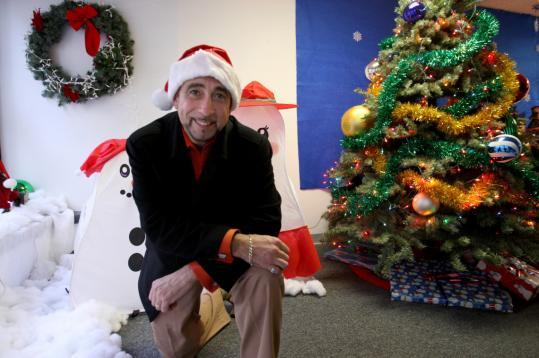 Parade organizer John Merian transformed his office into a holiday tribute to legendary Brockton businessman James Edgar, the first department store Santa Claus.