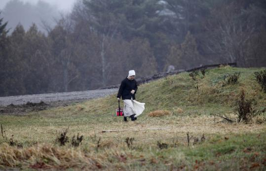 An Amish girl walked home from school in Unity, Maine. In the past year, eight Amish families have moved to the town.