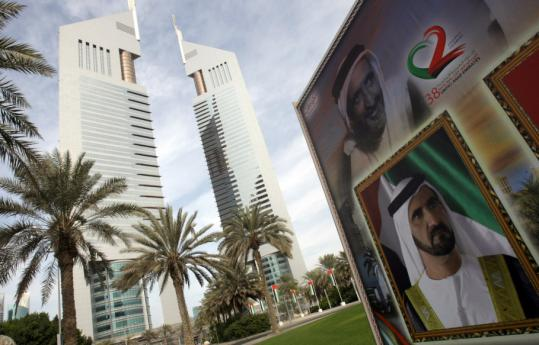 A billboard outside the Emirates Twin Towers displayed a picture of Dubai's ruler, Sheikh Mohammed bin Rashed al-Maktoum (bottom).