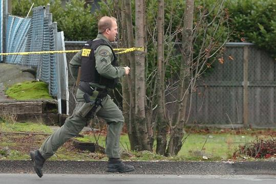 A Pierce County deputy sheriff ran toward the Forza Coffee Shop, where four police officers were killed yesterday.