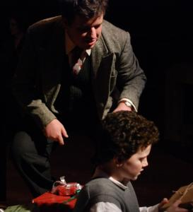 Stephen Libby as the adult Dylan Thomas watches himself as a 9-year-old, played by Adam Freeman.
