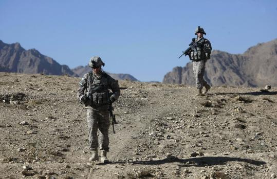 Lieutenant Caitlin Kee (right) of Princeton, Mass., and Second Lieutenant Dan Jindrich of McCall, Idaho, members of the Army's Third Brigade Special Troops Battalion, patrolled recently near Pul-i-alam, Logar Province, Afghanistan.
