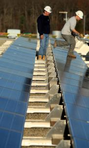 Nexamp employees installed solar panels atop NewStream in Attleboro last month.