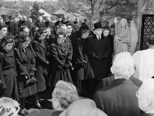 Mourners at the funeral of William Cardinal O' Connell bowed heads after his body was carried inside the crypt on the grounds of the Diocesan estate in Bright