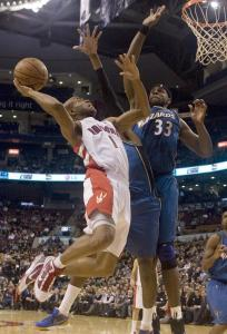 Toronto's Jarrett Jack had to reach back to score over the defense of Washington's Nick Young and Brendan Haywood.