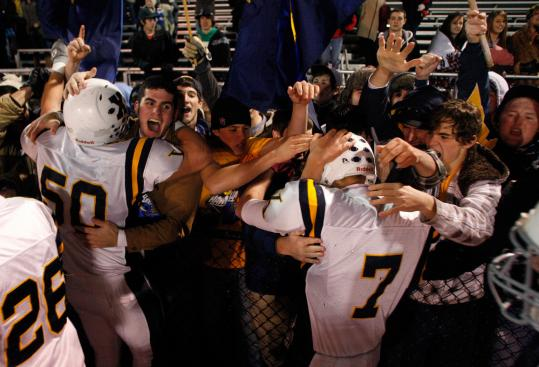 Xaverian players and fans came together as one to celebrate a trip to the Division 1 Super Bowl Saturday against Everett.