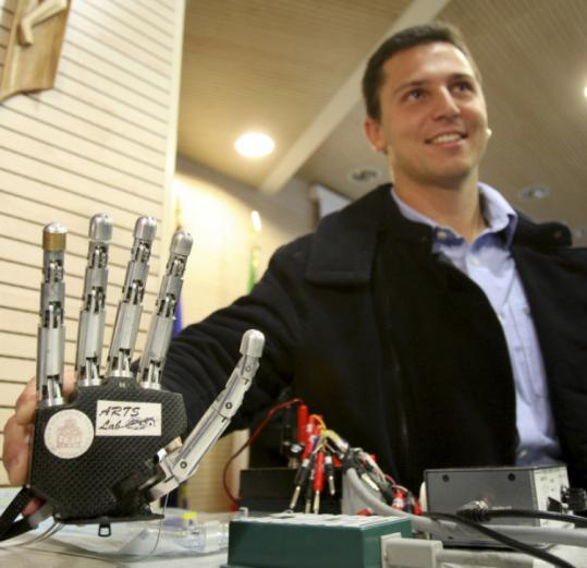 Amputee Pierpaolo Petruzziello showed off the robotic hand yesterday. He used the device during a one-month experiment.
