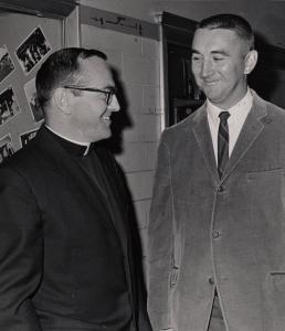 At BC High in 1967, the Rev. Charles McCoy talked with his former student James Cotter, the school's football coach.