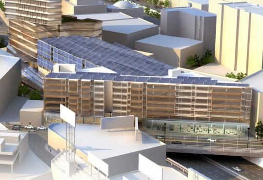 The proposed solar components at Fenway Center feature an array on top of the shared-use air rights garage and a vertical array on the south face of the garage.