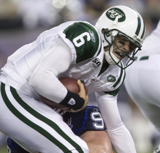 Jets quarterback Mark Sanchez was sacked in the first half, then hurt his knee on an 8-yard scamper in the third quarter.