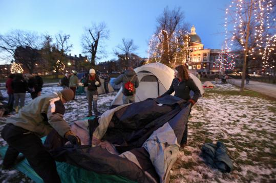 "Sarah Yoss (right) and three other Tufts students prepared to erect their tent on snow-crusted Boston Common last night, a gesture aimed at drawing attention to what they call ""dirty electricity''."