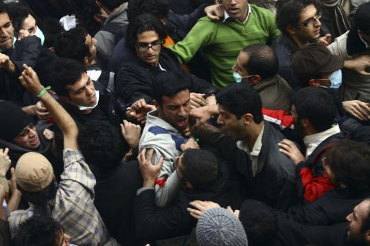 Hard-line and reform students scuffled during demonstrations at the Tehran University campus in Iran yesterday. The demonstrations, marking National Students Day, received international coverage despite a government ban on foreign media.