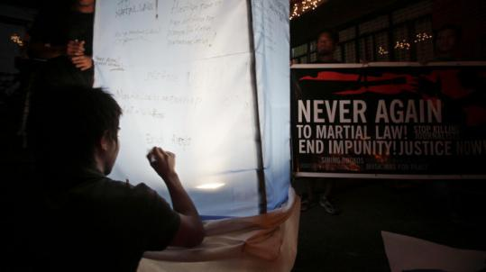 Students wrote messages on a lantern during a protest against martial law yesterday in Maguindanao Province.