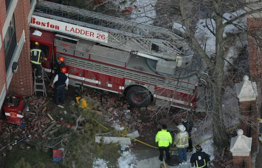 Fire officials at the site of a fatal fire truck crash on Huntington Avenue on Jan. 9.