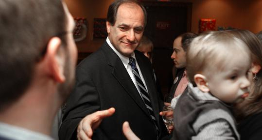 Michael Capuano campaigning before the primary at a local restaurant.