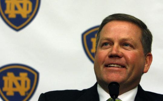 Brian Kelly, who leaves Cincinnati after a 12-0 season, will look to turn around the Irish.
