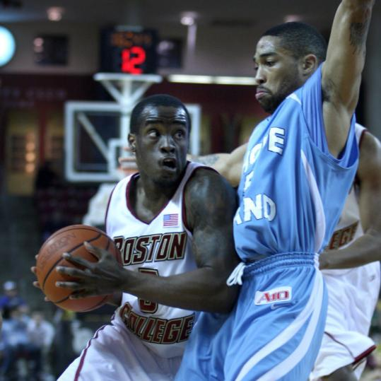 Eagles guard Biko Paris (10 points) tries to drive past URI guard Marquis Jones in the first half.
