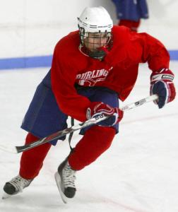 Forward Ryan Collins, shown during a recent practice, is expected to help anchor Burlington's top line as it tries to replace last year's top scorers.