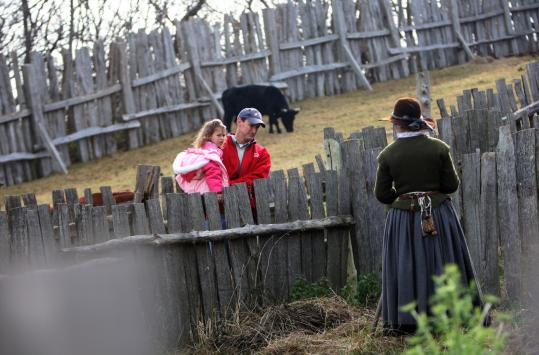 Keith Gizzi of Plymouth with his daughter, Lucia, 3, talk with a Plimoth Plantation interpreter while on a preschool field trip after Thanksgiving.