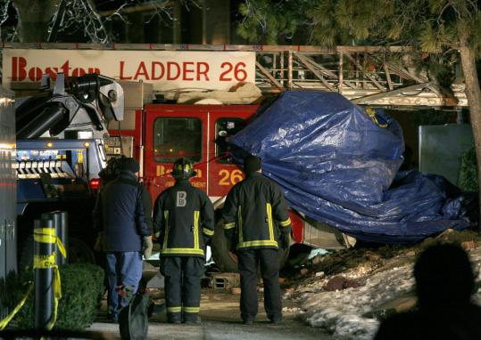 Ladder 26 was pulled from a building after its deadly crash. Police officials concluded that the brakes were manually adjusted repeatedly, which may have masked deficient performance.