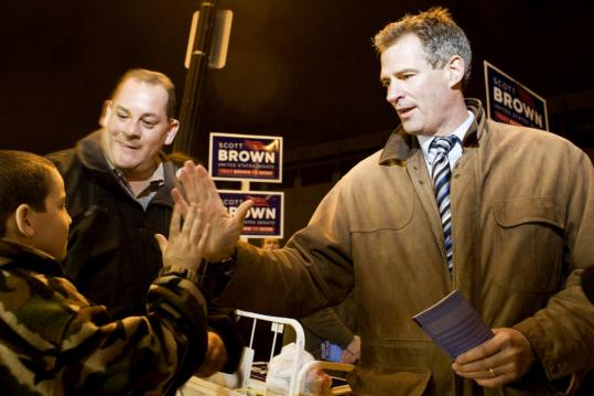 Scott Brown greeted Matthew Miller, 8, at North Station Monday. Brown is trying to become the first Republican elected senator from Massachusetts since 1972.