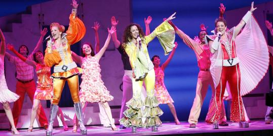 "Foreground, from left: Rachel Tyler as Tanya, Michelle Dawson as Donna, and Kittra Wynn Cooper as Rosie in ""Mamma Mia!'' at the Colonial Theatre."