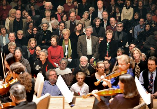 "An audience divided: A portion of the crowd stands for the ""Hallelujah'' chorus at a recent Handel and Haydn Society performance."