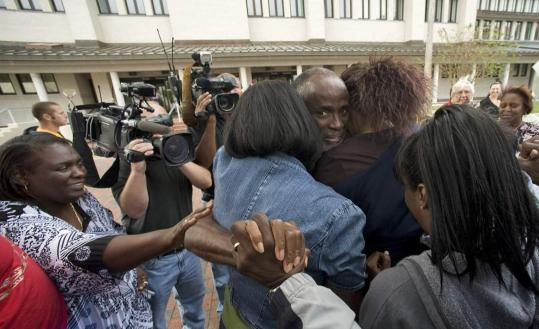 Relatives and friends greeted James Bain yesterday outside Polk County Courthouse in Bartow, Fla.