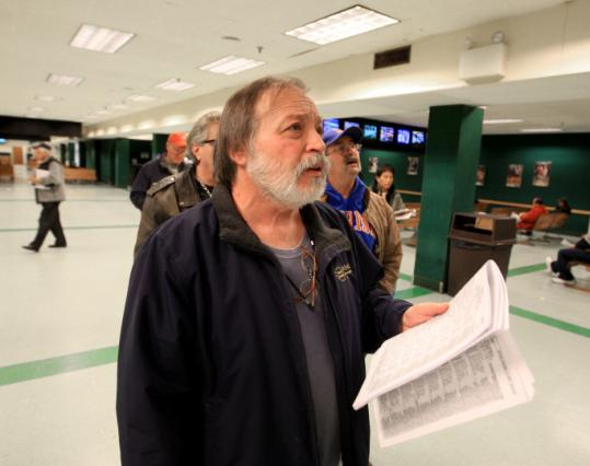 Ken Wagner looked to make a bet while at Raynham-Taunton Greyhound Park last weekend.