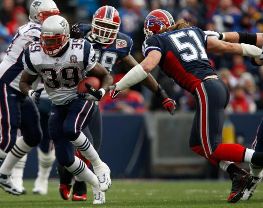 Patriots running back Laurence Maroney breaks past Buffalo linebacker Paul Posluszny and into the Bills' secondary.