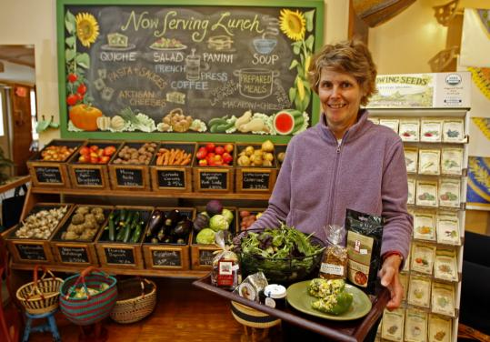 Margie Baldwin opened How on Earth, with meals to go and local produce, with her husband, Michael, two years ago.