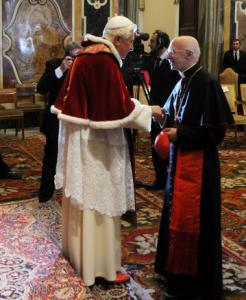 Pope Benedict XVI (left), at a Vatican City Christmas ceremony yesterday, will still visit Rome's main synagogue Jan. 17 as scheduled.