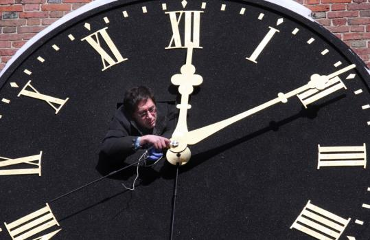 David Hochstrasser adjusted the hands of the 243-year-old clock at the Old South Meeting House in Boston yesterday. The clock had been taken down in August, fixed, and restored.
