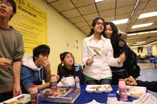 Students Christopher Li, William Wong, Anna Tse, Anielly Zeferino, and Pamela Ferreira unite at Malden High.