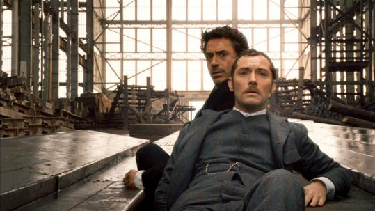 WARNER BROS. PICTURES Robert Downey Jr. (left) and Jude Law make a solid pairing as the legendary team of Sherlock Holmes and Dr. Watson.